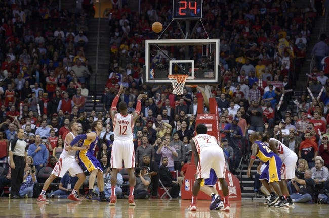 Nov 7, 2013; Houston, TX, USA; Houston Rockets center Dwight Howard (12) misses a free throw after being intentionally fouled against the Los Angeles Lakers during the fourth quarter at Toyota Center. The Lakers won 99-98. Mandatory Credit: Thomas Campbell-USA TODAY Sports
