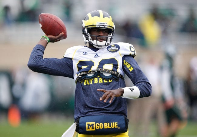 Nov 2, 2013; East Lansing, MI, USA; Michigan Wolverines quarterback Devin Gardner (98) warms up before the game against the Michigan State Spartans at Spartan Stadium. The Spartans beat the Wolverines 29-6. Mandatory Credit: Raj Mehta-USA TODAY Sports