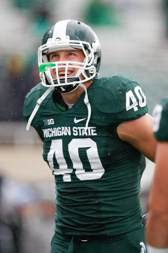 Nov 2, 2013; East Lansing, MI, USA; Michigan State Spartans linebacker Max Bullough (40) smiles before the game against the Michigan Wolverines at Spartan Stadium. The Spartans beat the Wolverines 29-6. Mandatory Credit: Raj Mehta-USA TODAY Sports