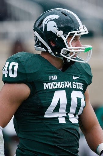 Nov 2, 2013; East Lansing, MI, USA; Michigan State Spartans linebacker Max Bullough (40) warms up before the game against the Michigan Wolverines at Spartan Stadium. The Spartans beat the Wolverines 29-6. Mandatory Credit: Raj Mehta-USA TODAY Sports