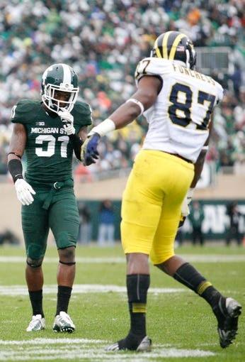 Nov 2, 2013; East Lansing, MI, USA; Michigan State Spartans cornerback Darqueze Dennard (31) looks at Michigan Wolverines tight end Devin Funchess (87) during the first quarter at Spartan Stadium. The Spartans beat the Wolverines 29-6. Mandatory Credit: Raj Mehta-USA TODAY Sports