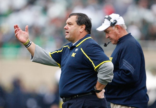 Nov 2, 2013; East Lansing, MI, USA; Michigan Wolverines head coach Brady Hoke (left) and defensive coordinator Greg Mattison (right) during the first quarter against the Michigan State Spartans at Spartan Stadium. The Spartans beat the Wolverines 29-6. Mandatory Credit: Raj Mehta-USA TODAY Sports
