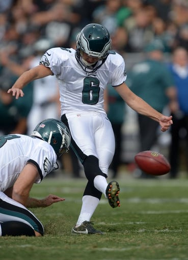Nov 3, 2013; Oakland, CA, USA; Philadelphia Eagles kicker Alex Henery (6) attempts an extra point out of the hold of Donnie Jones (8) against the Oakland Raiders at O.co Coliseum. The Eagles defeated the Raiders 49-20. Mandatory Credit: Kirby Lee-USA TODAY Sports