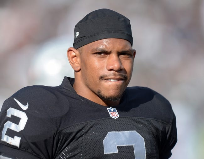 Nov 3, 2013; Oakland, CA, USA; Oakland Raiders quarterback Terrelle Pryor (2) reacts during the game against the Philadelphia Eagles at O.co Coliseum. The Eagles defeated the Raiders 49-20. Mandatory Credit: Kirby Lee-USA TODAY Sports