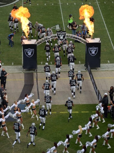 Nov 3, 2013; Oakland, CA, USA; General view of Oakland Raiders players running onto the field through flames before the game against the Philadelphia Eagles at O.co Coliseum. Mandatory Credit: Kirby Lee-USA TODAY Sports