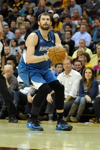 Nov 4, 2013; Cleveland, OH, USA; Minnesota Timberwolves power forward Kevin Love (42) during a game against the Cleveland Cavaliers at Quicken Loans Arena. Cleveland won 93-92. Mandatory Credit: David Richard-USA TODAY Sports