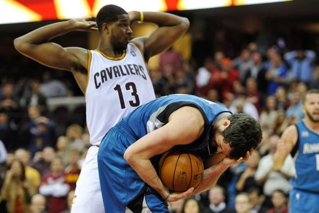Nov 4, 2013; Cleveland, OH, USA; Minnesota Timberwolves power forward Kevin Love (42) reacts after he was poked in the face by Cleveland Cavaliers power forward Tristan Thompson (13) during a game at Quicken Loans Arena. Cleveland won 93-92. Mandatory Credit: David Richard-USA TODAY Sports