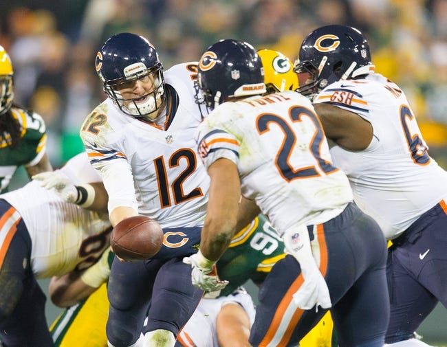 Nov 4, 2013; Green Bay, WI, USA; Chicago Bears quarterback Josh McCown (12) hands the football to running back Matt Forte (22) during the game against the Green Bay Packers at Lambeau Field. Chicago won 27-20.  Mandatory Credit: Jeff Hanisch-USA TODAY Sports