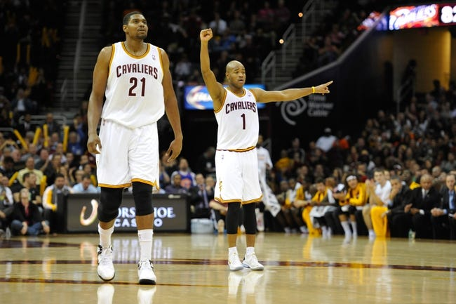 Nov 4, 2013; Cleveland, OH, USA; Cleveland Cavaliers center Andrew Bynum (21) and point guard Jarrett Jack (1) during a game against the Minnesota Timberwolves at Quicken Loans Arena. Cleveland won 93-92. Mandatory Credit: David Richard-USA TODAY Sports