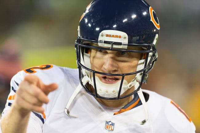 Nov 4, 2013; Green Bay, WI, USA; Chicago Bears quarterback Josh McCown (12) during warmups prior to the game against the Green Bay Packers at Lambeau Field. Chicago won 27-20.  Mandatory Credit: Jeff Hanisch-USA TODAY Sports
