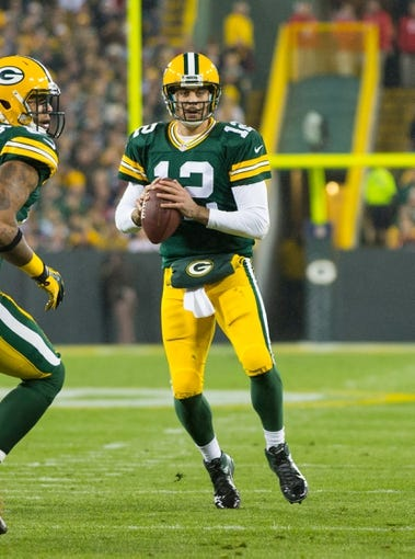 Nov 4, 2013; Green Bay, WI, USA; Green Bay Packers quarterback Aaron Rodgers (12) during the game against the Chicago Bears at Lambeau Field. Chicago won 27-20.  Mandatory Credit: Jeff Hanisch-USA TODAY Sports