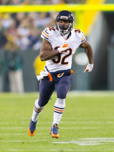 Nov 4, 2013; Green Bay, WI, USA; Chicago Bears running back Michael Ford (32) during the game against the Green Bay Packers at Lambeau Field. Chicago won 27-20.  Mandatory Credit: Jeff Hanisch-USA TODAY Sports