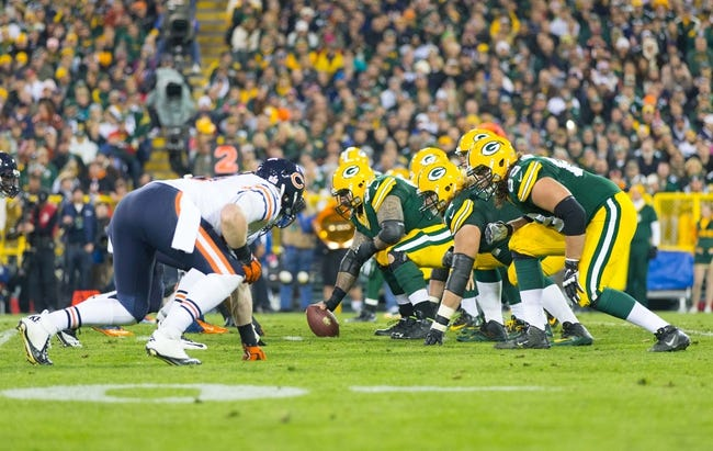 Nov 4, 2013; Green Bay, WI, USA; The Green Bay Packers line up for a play during the game against the Chicago Bears at Lambeau Field. Chicago won 27-20.  Mandatory Credit: Jeff Hanisch-USA TODAY Sports