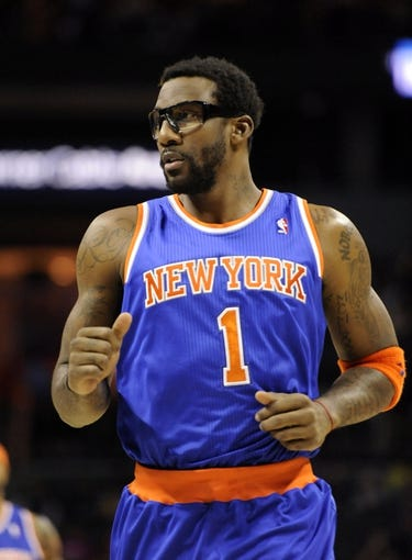 Nov 8, 2013; Charlotte, NC, USA; New York Knicks forward center Amar'e Stoudemire (1) runs doe the court during the game against the Charlotte Bobcats at Time Warner Cable Arena. Mandatory Credit: Sam Sharpe-USA TODAY Sports