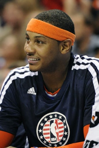 Nov 8, 2013; Charlotte, NC, USA; New York Knicks forward Carmelo Anthony (7) takes a break during the game against the Charlotte Bobcats at Time Warner Cable Arena. Mandatory Credit: Sam Sharpe-USA TODAY Sports