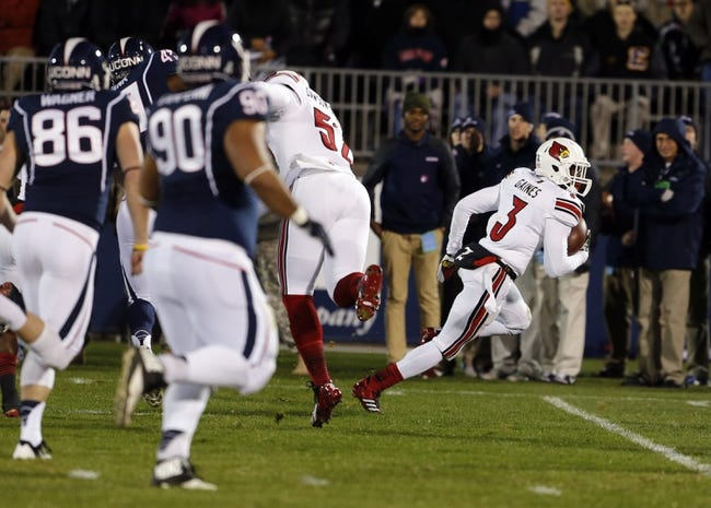 Nov 8, 2013; East Hartford, CT, USA; Louisville Cardinals cornerback Charles Gaines (3) blocks the kick and returns the ball for a touchdown against by Connecticut Huskies punter Cole Wagner (86) in the first quarter at Rentschler Field. Mandatory Credit: David Butler II-USA TODAY Sports