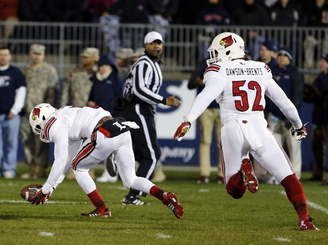 Nov 8, 2013; East Hartford, CT, USA; Louisville Cardinals cornerback Charles Gaines (3) blocks the kick and returns the ball for a touchdown against by Connecticut Huskies punter Cole Wagner (not pictured) in the first quarter at Rentschler Field. Mandatory Credit: David Butler II-USA TODAY Sports