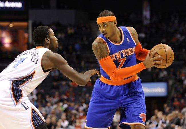 Nov 8, 2013; Charlotte, NC, USA; (Editors note: Caption correction) New York Knicks forward Carmelo Anthony (7) looks to drive past Charlotte Bobcats forward Michael Kidd-Gilchrist (14) during the game at Time Warner Cable Arena. Mandatory Credit: Sam Sharpe-USA TODAY Sports
