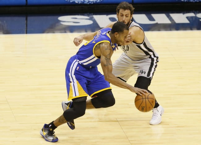 Nov 8, 2013; San Antonio, TX, USA; Golden State Warriors forward Andre Iguodala (front) drives past San Antonio Spurs forward Marco Belinelli (behind) during the first half at AT&T Center. Mandatory Credit: Soobum Im-USA TODAY Sports