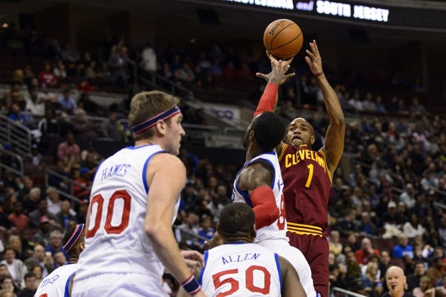 Nov 8, 2013; Philadelphia, PA, USA; Cleveland Cavaliers guard Jarrett Jack (1) shoots over the defense of Philadelphia 76ers guard Tony Wroten (8) during the third quarter at Wells Fargo Center. The Sixers defeated the Cavaliers 94-79. Mandatory Credit: Howard Smith-USA TODAY Sports