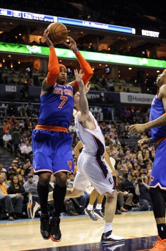 Nov 8, 2013; Charlotte, NC, USA; New York Knicks forward Carmelo Anthony (7) and Charlotte Bobcats forward Cody Zeller (40) fight for a rebound during the game at Time Warner Cable Arena. Knicks win 101-91. Mandatory Credit: Sam Sharpe-USA TODAY Sports