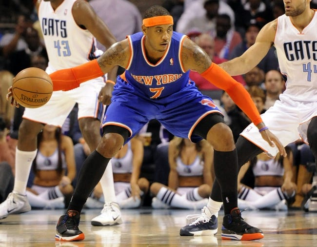 Nov 8, 2013; Charlotte, NC, USA; New York Knicks forward Carmelo Anthony (7) during the game against the Charlotte Bobcats at Time Warner Cable Arena. Knicks win 101-91. Mandatory Credit: Sam Sharpe-USA TODAY Sports