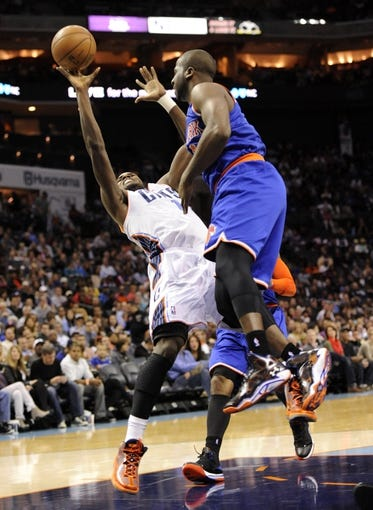 Nov 8, 2013; Charlotte, NC, USA; Charlotte Bobcats forward Michael Kidd-Gilchrist (14) gets fouled by New York Knicks guard Raymond Felton (2) during the game at Time Warner Cable Arena. Knicks win 101-91. Mandatory Credit: Sam Sharpe-USA TODAY Sports
