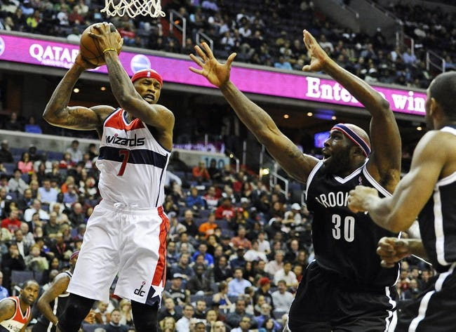 Nov 8, 2013; Washington, DC, USA; Washington Wizards power forward Al Harrington (7) grabs a rebound in front of Brooklyn Nets power forward Reggie Evans (30) during the second half at the Verizon Center. The Wizards defeated the Nets 112 - 108. Mandatory Credit: Brad Mills-USA TODAY Sports