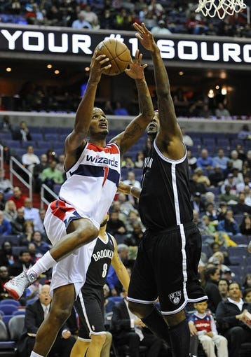 Nov 8, 2013; Washington, DC, USA; Washington Wizards small forward Trevor Ariza (1) drives to the basket as Brooklyn Nets center Andray Blatche (0) defends during the first half at the Verizon Center. Mandatory Credit: Brad Mills-USA TODAY Sports