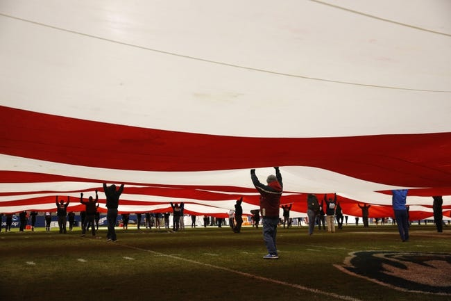 Nov 8, 2013; East Hartford, CT, USA; The American flag is unfurled prior to the game between the Connecticut Huskies and the Louisville Cardinals at Rentschler Field. Mandatory Credit: David Butler II-USA TODAY Sports