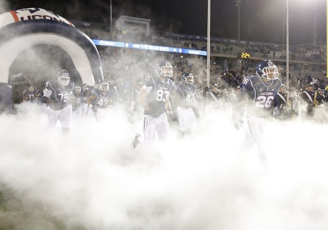 Nov 8, 2013; East Hartford, CT, USA; The Connecticut Huskies take the field prior to the game against the Louisville Cardinals at Rentschler Field. Mandatory Credit: David Butler II-USA TODAY Sports