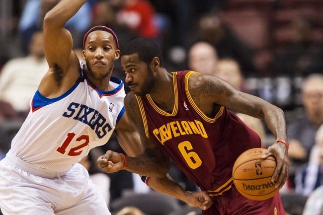 Nov 8, 2013; Philadelphia, PA, USA; Cleveland Cavaliers forward Earl Clark (6) is defended by Philadelphia 76ers guard Evan Turner (12) during the first quarter at Wells Fargo Center. The Sixers defeated the Cavaliers 94-79. Mandatory Credit: Howard Smith-USA TODAY Sports