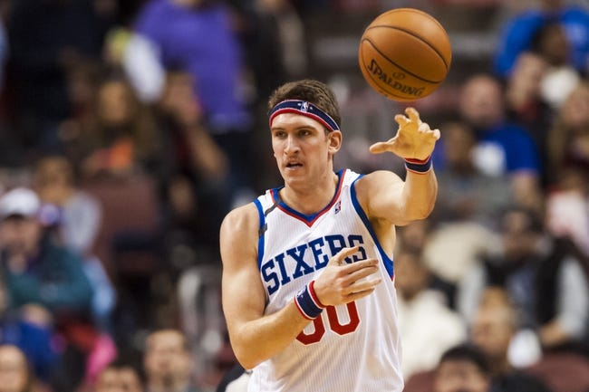 Nov 8, 2013; Philadelphia, PA, USA; Philadelphia 76ers center Spencer Hawes (00) passes the ball during the third quarter against the Cleveland Cavaliers at Wells Fargo Center. The Sixers defeated the Cavaliers 94-79. Mandatory Credit: Howard Smith-USA TODAY Sports