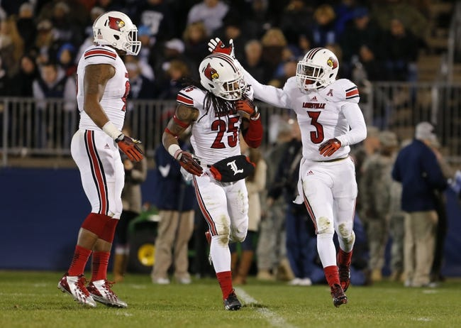 Nov 8, 2013; East Hartford, CT, USA; Louisville Cardinals cornerback Charles Gaines (3) reacts with teammate safety Calvin Pryor (25) after intercepting a pass intended for Connecticut Huskies wide receiver Shakim Phillips (8) (not pictured) in the second quarter at Rentschler Field. Mandatory Credit: David Butler II-USA TODAY Sports