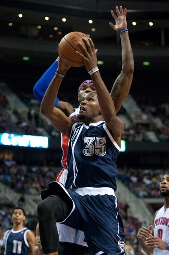Nov 8, 2013; Auburn Hills, MI, USA; Oklahoma City Thunder small forward Kevin Durant (35) goes to the basket against Detroit Pistons small forward Josh Smith (6) during the second quarter at The Palace of Auburn Hills. Mandatory Credit: Tim Fuller-USA TODAY Sports