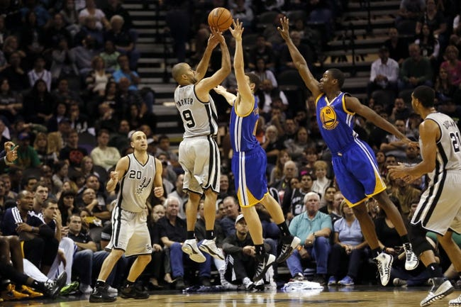 Nov 8, 2013; San Antonio, TX, USA; San Antonio Spurs guard Tony Parker (9) takes a shot over Golden State Warriors guard Klay Thompson (11) during the second half at AT&T Center. The Spurs won 76-74. Mandatory Credit: Soobum Im-USA TODAY Sports