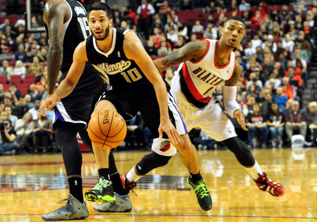 Nov 8, 2013; Portland, OR, USA; Sacramento Kings point guard Greivis Vasquez (10) has the ball poked away from behind by Portland Trail Blazers point guard Damian Lillard (0) during the first quarter of the game at the Moda Center. Mandatory Credit: Steve Dykes-USA TODAY Sports