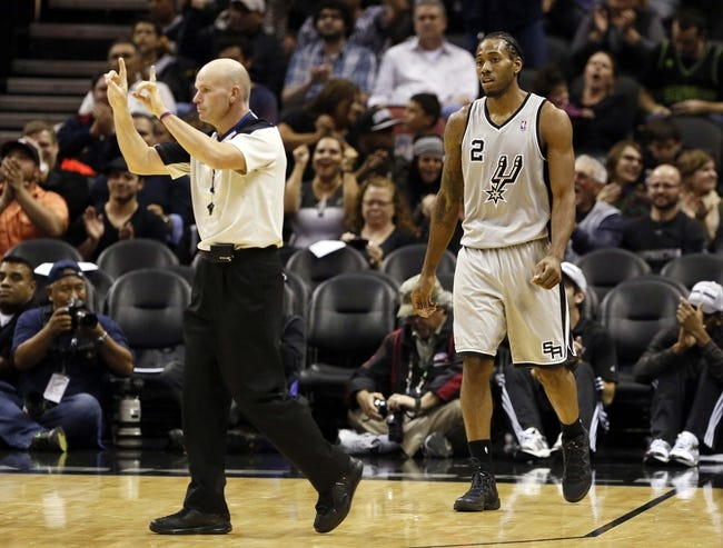 Nov 8, 2013; San Antonio, TX, USA; San Antonio Spurs forward Kawhi Leonard (2) reacts after a shot against the Golden State Warriors during the second half at AT&T Center. The Spurs won 76-74. Mandatory Credit: Soobum Im-USA TODAY Sports