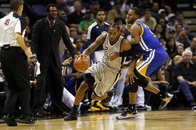 Nov 8, 2013; San Antonio, TX, USA; San Antonio Spurs forward Kawhi Leonard (2) moves the ball against the defense of Golden State Warriors forward Andre Iguodala (right) during the second half at AT&T Center. The Spurs won 76-74. Mandatory Credit: Soobum Im-USA TODAY Sports