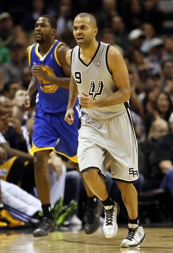 Nov 8, 2013; San Antonio, TX, USA; San Antonio Spurs guard Tony Parker (9) reacts after a shot against the Golden State Warriors during the second half at AT&T Center. The Spurs won 76-74. Mandatory Credit: Soobum Im-USA TODAY Sports