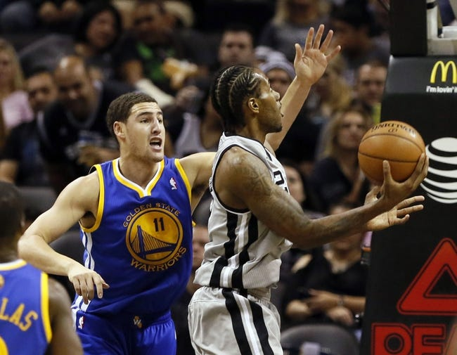 Nov 8, 2013; San Antonio, TX, USA; San Antonio Spurs forward Kawhi Leonard (2) drives to the basket as Golden State Warriors guard Klay Thompson (11) defends during the second half at AT&T Center. The Spurs won 76-74. Mandatory Credit: Soobum Im-USA TODAY Sports