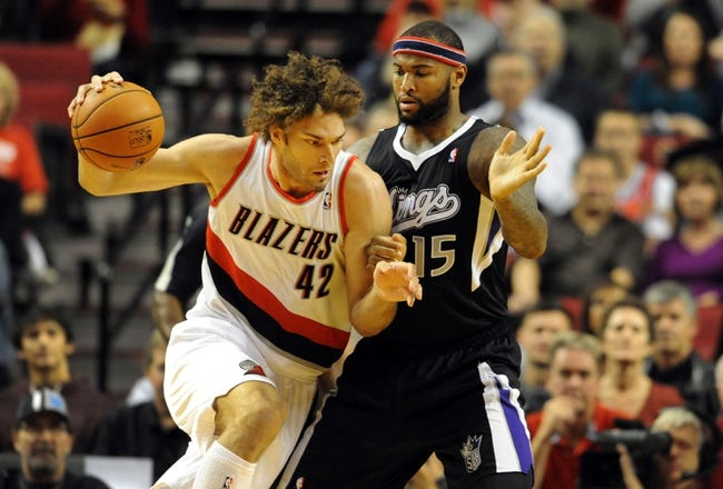 Nov 8, 2013; Portland, OR, USA; Portland Trail Blazers center Robin Lopez (42) drives to the basket on Sacramento Kings center DeMarcus Cousins (15) during the first quarter of the game at the Moda Center. Mandatory Credit: Steve Dykes-USA TODAY Sports