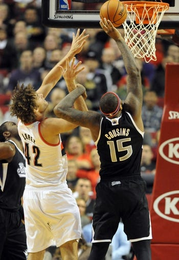 Nov 8, 2013; Portland, OR, USA; Portland Trail Blazers center Robin Lopez (42) battles for a rebound with  Sacramento Kings center DeMarcus Cousins (15) during the first quarter of the game at the Moda Center. Mandatory Credit: Steve Dykes-USA TODAY Sports
