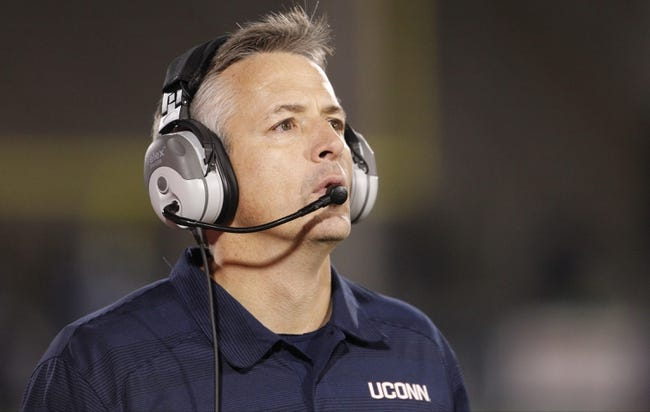 Nov 8, 2013; East Hartford, CT, USA; Connecticut Huskies interim head coach T.J. Weist watches from the sideline as they take on the Louisville Cardinals in the second half at Rentschler Field. Louisville defeated UConn 31-10. Mandatory Credit: David Butler II-USA TODAY Sports