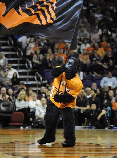 Nov 8, 2013; Phoenix, AZ, USA; The Phoenix Suns Gorilla waves a flag during the fourth quarter against the Denver Nuggets at US Airways Center. The Suns defeated the Nuggets 114-103. Mandatory Credit: Casey Sapio-USA TODAY Sports