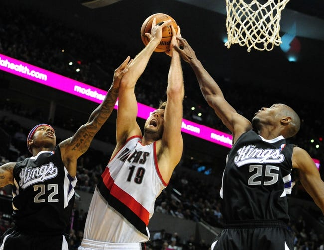 Nov 8, 2013; Portland, OR, USA; Sacramento Kings point guard Isaiah Thomas (22), Portland Trail Blazers center Joel Freeland (19) and Sacramento Kings small forward Travis Outlaw (25) go up for a rebound during the fourth quarter of the game at the Moda Center. The Blazers won the game 104-91. Mandatory Credit: Steve Dykes-USA TODAY Sports
