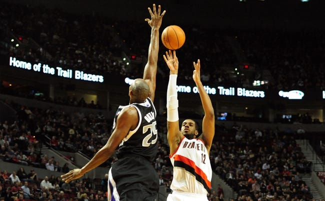 Nov 8, 2013; Portland, OR, USA; Portland Trail Blazers power forward LaMarcus Aldridge (12) shoots over Sacramento Kings small forward Travis Outlaw (25) during the fourth quarter of the game at the Moda Center. The Blazers won the game 104-91. Mandatory Credit: Steve Dykes-USA TODAY Sports