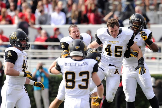 Nov 9, 2013; Athens, GA, USA; Appalachian State Mountaineers linebacker Karl Anderson (45) reacts with team mates after making an interception against the Georgia Bulldogs during the first quarter at Sanford Stadium. Mandatory Credit: Dale Zanine-USA TODAY Sports
