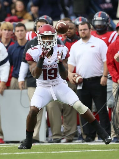 Nov 9, 2013; Oxford, MS, USA; Arkansas Razorbacks wide receiver Javontee Herndon (19) makes a catch during the game against the Mississippi Rebels at Vaught-Hemingway Stadium. Mandatory Credit: Spruce Derden-USA TODAY Sports