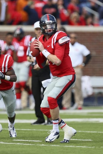 Nov 9, 2013; Oxford, MS, USA; Mississippi Rebels quarterback Bo Wallace (14) drops back to pass the ball during the game against the Arkansas Razorbacks at Vaught-Hemingway Stadium. Mandatory Credit: Spruce Derden-USA TODAY Sports